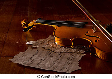 Violin sheet and music on wooden floor with soft light