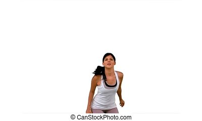 Fit woman jumping up and posing