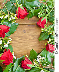 Wooden background with red roses - Wooden background with a...