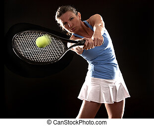 tennis woman - brunette playing tennis on black background