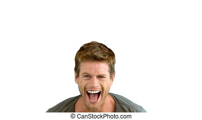 Handsome man laughing on white background