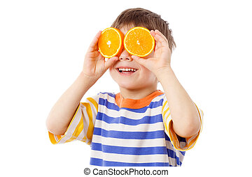Funny boy with fruits on eyes