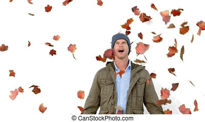 Amazed man looking at falling leaves on white screen in slow...