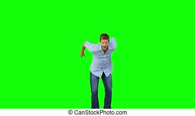 Man jumping to show his triumph on green screen in slow...