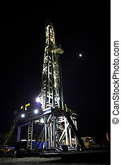 Drilling Rig at Night - Drilling Rig at night with shining...
