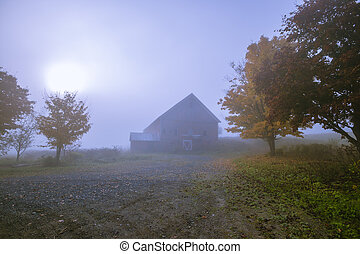 Old barn on a foggy blue autumn morning in Vermont - Old red...