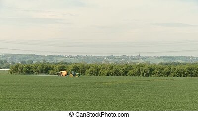 Tractor spraying on field - video footage of a tractor on a...
