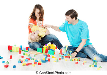 Happy family. Parents playing with child over white