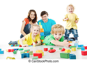 Happy family. Parents with three kids playing blocks over...