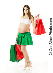 Beautiful pregnant woman with shopping bags over white