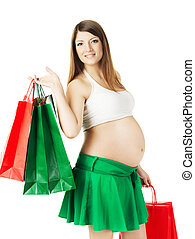 Beautiful pregnant woman with shopping bags