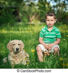 Child and golden retriever - A little boy and his dog
