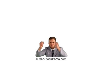 Excited businessman jumping on white background in slow...