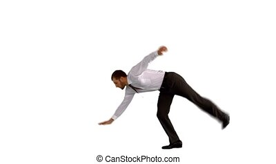 Businessman doing handstand with legs outstretched in slow...