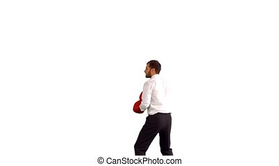 Businessman in boxing gloves jumping