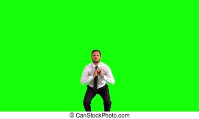 Businessman jumping and stretching his body towards the...