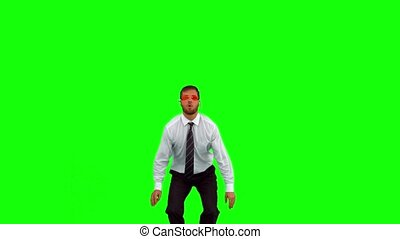 Businessman wearing swimming goggles jumping on green screen...