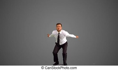 Businessman jumping and punching the air