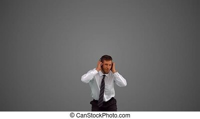Businessman jumping and listening t