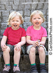 Adorable happy identical twins - Adorable happy identical...
