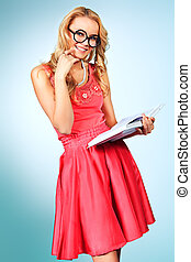 funny student - Pretty blonde woman with a book posing at...