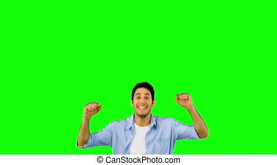 Man jumping for joy on green screen