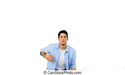 Man playing air guitar on white background in slow motion