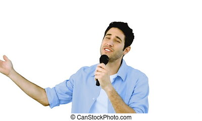 Man singing into microphone with emotion on white background...