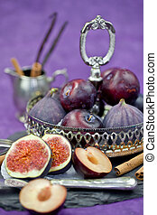 Plums and figs in a vintage bowl