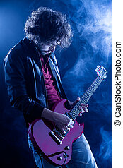 Rock Guitarist - Young Man Playing Electric Guitar