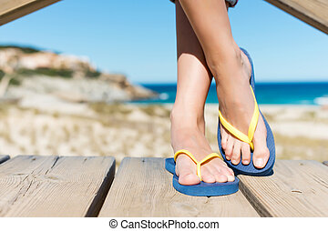 Woman Wearing Flip-Flops While Standing On Board Walk - Low...