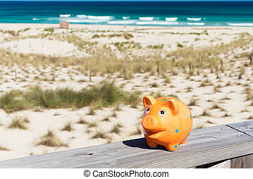 piggybank in holidays - piggybank standing on stage by the...