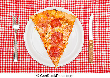 Pepperoni pizza slice on white plate