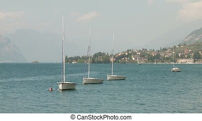 Boats on Lake Garda, Italy - sailboats at the lake garda,...