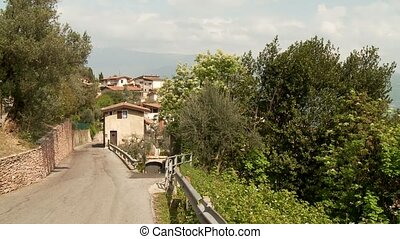 Street with village, Italy - road at the lake garda in...