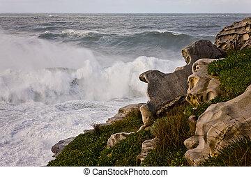 Waves breaking on a rocky shoreline