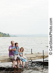Family on a wharf