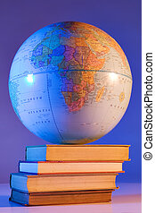 Worldly education - Globe on stack of books