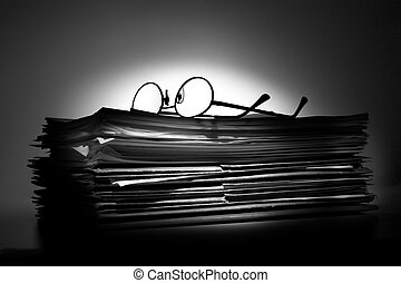 Pile of paperwork - Glasses on a stack of papers and folders...
