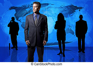 Global business team - Business professionals standing in...