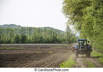 Tractor on path - Farmer checking mechanization before...