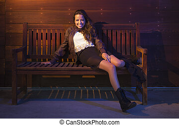 Mixed Race Young Adult Woman Portrait Sitting on Wood Bench