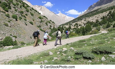 hiking group walking through valley