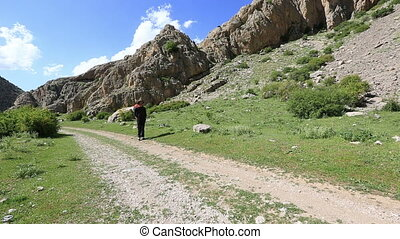 hiker - Adult male walking through valley