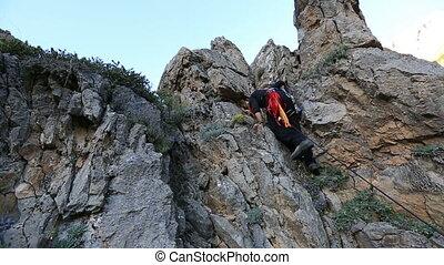 rock climber - climber climbing the top of the rock