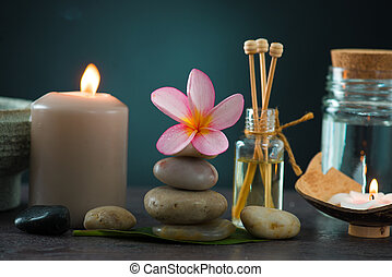 tropical frangipani spa health treatment with aroma therapy and hot stones, shot with ambient lights