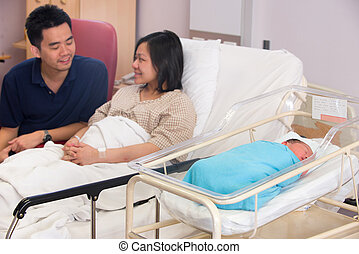 Asian newborn baby girl and daddy in hospital - Asian...