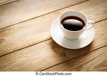 Cup of Coffee - Cup of coffee on a wooden table.