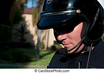 speeding ticket - a close up of a motorcycle police officer...