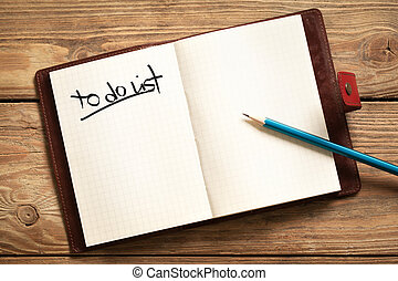 To Do List - Opened personal organizer with a to do list.